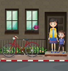 Boy and mother in front of a house vector