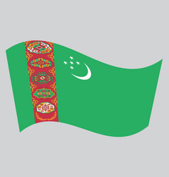 flag of turkmenistan waving on gray background vector image vector image