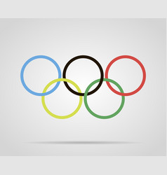 circles painted olympic rings over grey background vector image