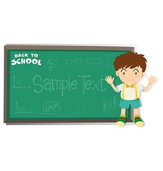 Little boy standing by the blackboard vector image vector image