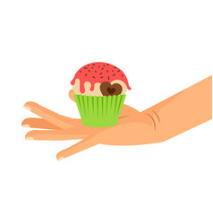 hand holding cupcake with chocolate heart vector image vector image