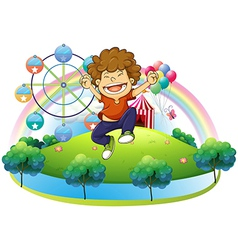 A happy boy in the hill with a carnival vector image