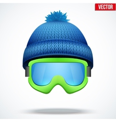 Knitted woolen blue cap with snow goggles winter vector