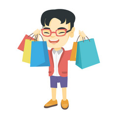 happy asian boy holding shopping bags vector image