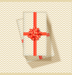 stack gift boxes with red ribbon and bow tie vector image