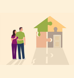 Young couple looking at house made from puzzle vector