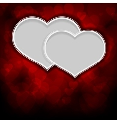 Two white hearts on a red background vector