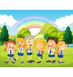 Children in uniform standing in the park vector image