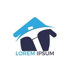 pickaxe and home mining logo design vector image