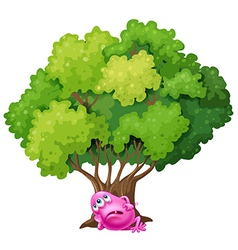 A pink monster resting under the tree vector image