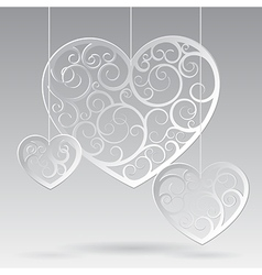 Paper suspended patterned hearts vector