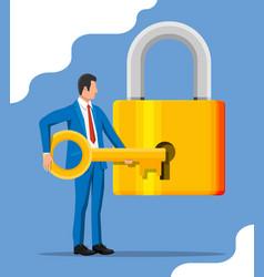 businessman unlocking huge padlock with key vector image