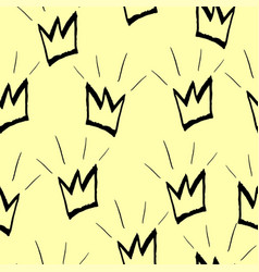 seamless pattern with black crowns on a yellow vector image