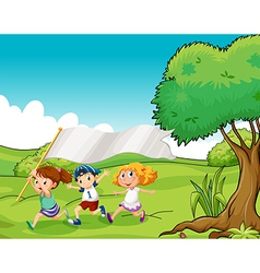 Three kids at the hilltop with an empty flag vector image vector image