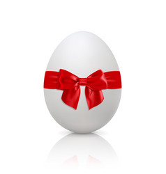 white egg with red bow vector image vector image