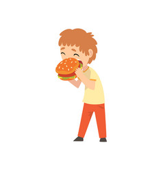 cute boy eating burger child enjoying eating of vector image