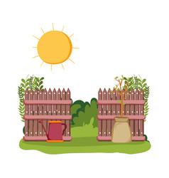 Sprinkler of garden with fence in the field scene vector