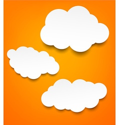 White paper clouds over orange background vector image