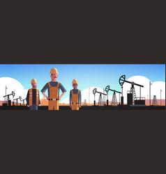 Workers in orange uniform working on oil drilling vector