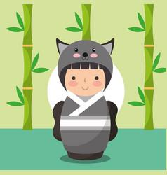 Japanese kokeshi doll in kimono animal costume vector