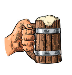 male hand holding full beer wooden mug with foam vector image