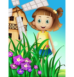 A girl watching the flowers in the garden near the vector image vector image