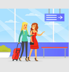 couple women with luggage walking at airport vector image