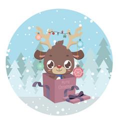 Cute reindeer in present box vector