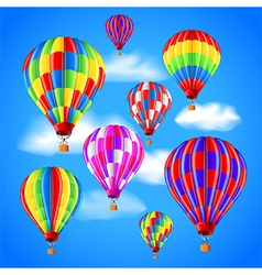 Hot air balloons in sky background vector