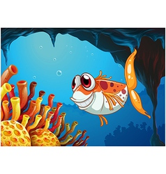 A smiling fish under the sea inside the cave vector