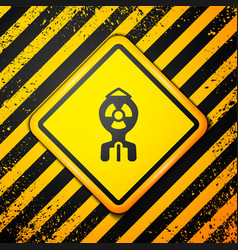 Black nuclear bomb icon isolated on yellow vector