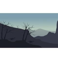 Silhouette of eoraptor walking in hills vector image