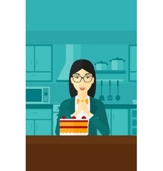 Woman looking at cake vector image