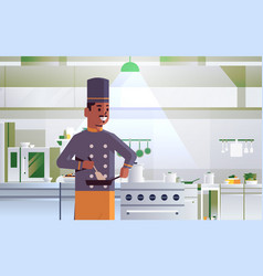 male professional chef using frying pan stirring vector image