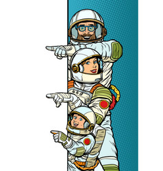 Family astronauts mom dad and son point to copy vector