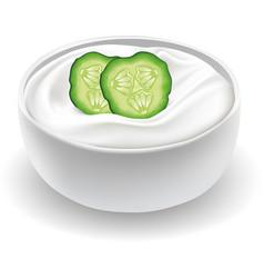 Fresh cucumber cream in white bowl vector