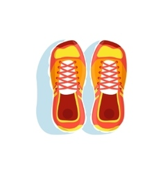 Pair of orange running shoes vector