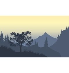 Silhouette of forest and mountain vector