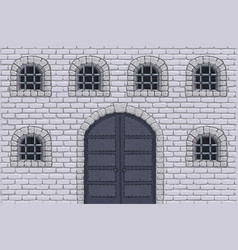 medieval castle wall with doors and barred windows vector image