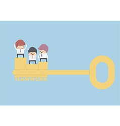 Businessman stand on the golden key teamwork conc vector