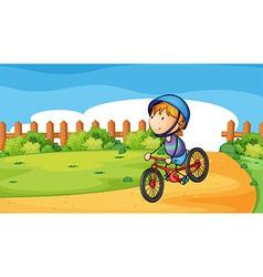 A young boy biking outdoor vector image