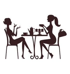 Two beautiful women sitting in a cafe vector image
