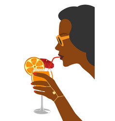 a glass of fresh orange juice in hand woman vector image vector image