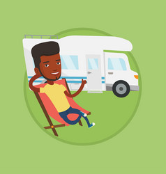 man sitting in chair in front of camper van vector image