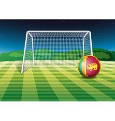 A soccer ball near the net with the flag of Sri vector