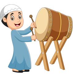 Cartoon muslim boy hitting bedug vector