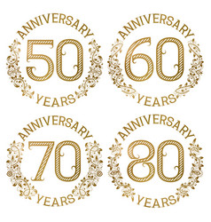 Set of golden anniversary emblems vector