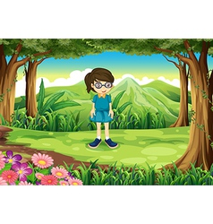 A schoolgirl in the middle of the forest vector image