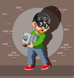 A thief who has stolen safe deposit box in his vector