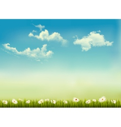 Retro nature background with green grass and sky vector image